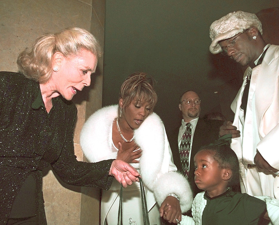 . Actress Lauren Bacall, left, greets Bobbi-Christina daughter of Bobby Brown, right, and Whitney Houston during the 4th Annual International Achievement In Arts Awards in Beverly Hills, Calif., Sunday, Oct. 11, 1998.   (AP Photo/Michael Caulfield)