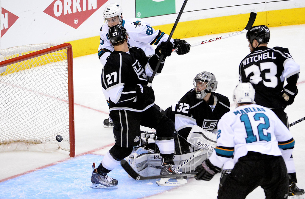 . San Jose Sharks left wing Matt Nieto (83) score past Los Angeles Kings goalie Jonathan Quick (32) and defenseman Alec Martinez (27) as Los Angeles Kings defenseman Willie Mitchell (33) and San Jose Sharks center Patrick Marleau (12) look on during the second period in Game 4 of an NHL hockey first-round playoff series at Staples Center in Los Angeles on Thursday, April, 24  2014.  (Keith Birmingham Pasadena Star-News)