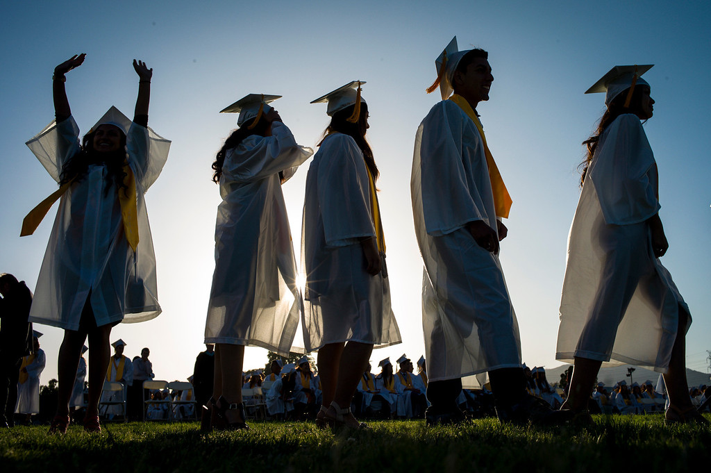 . Kennedy High school graduates step up to receive their diplomas Thursday, June 5, 2014.   ( Photo by David Crane/Los Angeles Daily News )