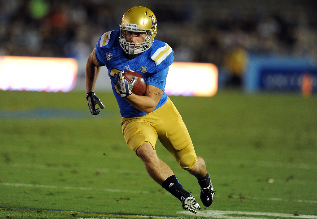 . UCLA running back Steven Manfro (33) runs for a touchdown against New Mexico State during the first half of their college football game in the Rose Bowl in Pasadena, Calif., on Saturday, Sept. 21, 2013.   (Keith Birmingham Pasadena Star-News)