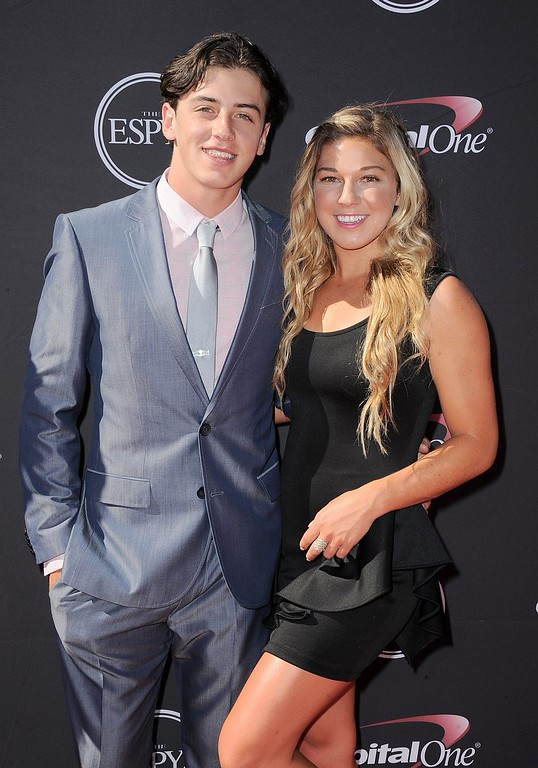 . Snowboarder Mark McMorris, left, and a guest arrive at the ESPY Awards on Wednesday, July 17, 2013, at Nokia Theater in Los Angeles. (Photo by Jordan Strauss/Invision/AP)