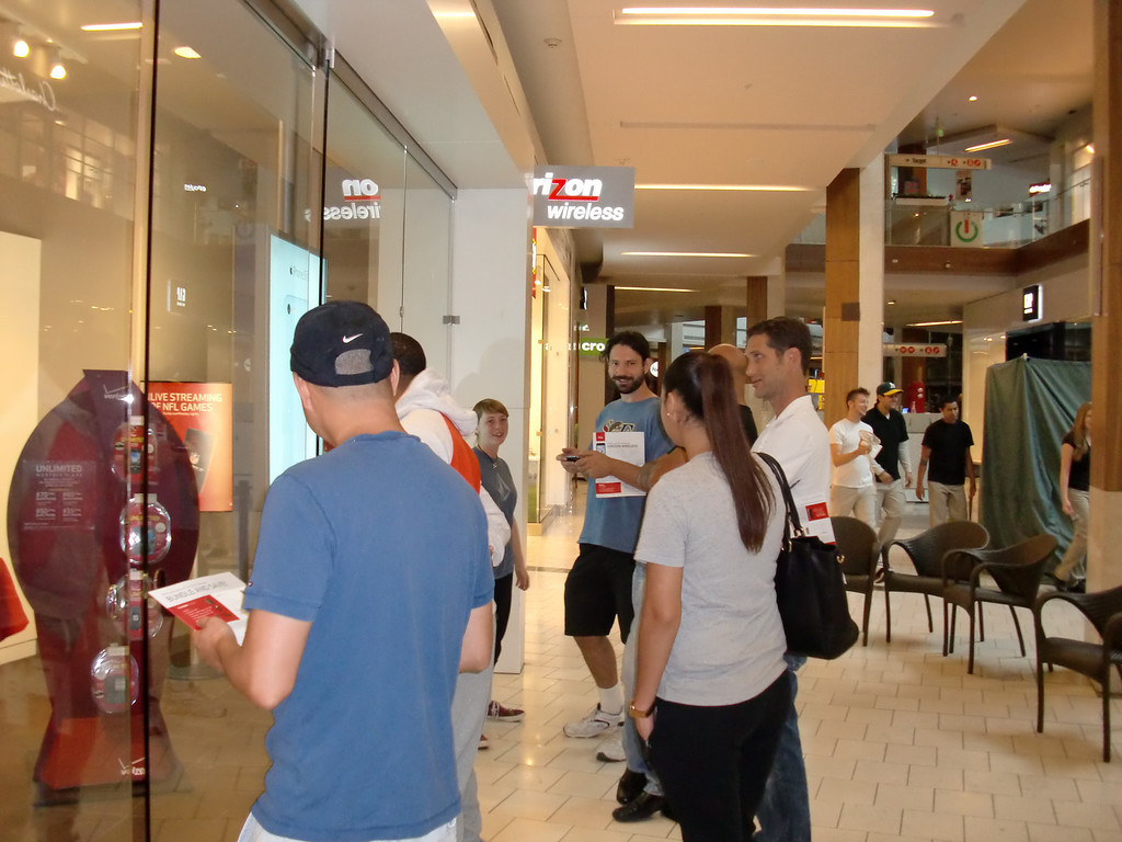 . A smaller line -- more of a gaggle really -- formed outside the Verizon Wireless store on the iPhone 5c and 5s debut day at the Westfield Topanga mall on Sept. 20, 2013. Like at the Apple Store upstairs, customers were let in one by one. (Photo by Steven Rosenberg/Los Angeles Daily News)