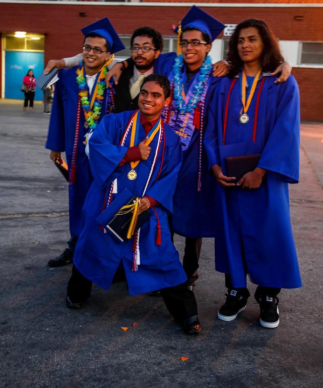 . After receiving their diplomas, graduates celebrate, at John H Francis Polytechnic High School, Sun Valley, Calif., June 7, 2013. Photo: Lynn Levitt.