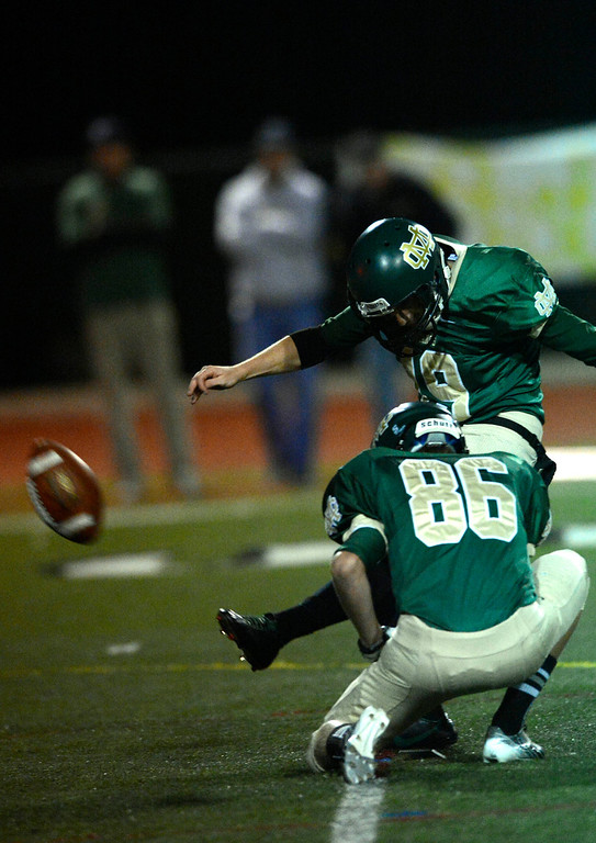 . Costa kicker Casey Sublette in  first-half game action in the CIF Southern Section Northern Division first-round football game between the Highland High School Bulldogs and Mira Costal Mustangs at Costa Friday evening, 11/15/2013.  Photo for The Daily Breeze by Axel Koester, 11/15/2013.