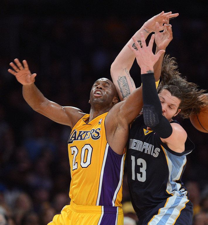 . The Lakers� Jodie Meeks #20 and the Grizzlies� Mike Miller #13 collied while going after a loose ball during  their game at the Staples Center in Los Angeles Friday, November 15, 2013. The Grizzlies beat the Lakers 89-86.  (Photo by Hans Gutknecht/Los Angeles Daily News)