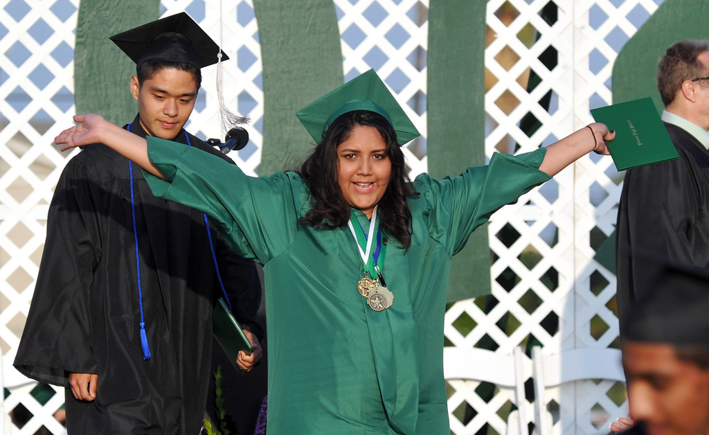 . Graduates get their diplomas on the field during the 53rd Commencement at Pioneer High School in Whittier on Wednesday June 12, 2013. (SGVN/Staff Photo by Keith Durflinger)