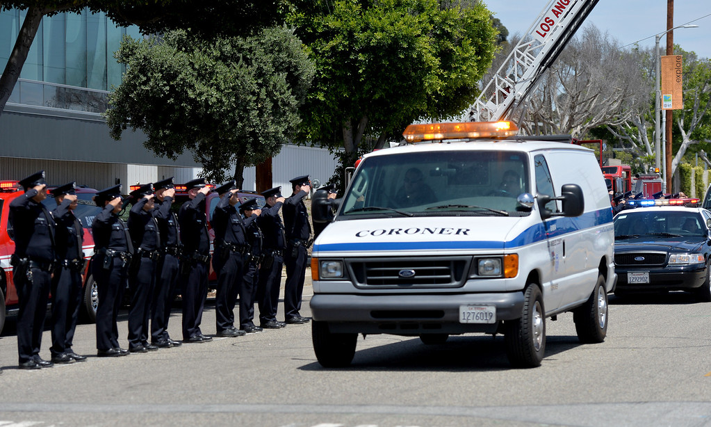 . Los Angeles police officers and firefighters lined the street in front of the Harbor Division as the coroners van was lead in procession with Officer Roberto Sanchez. San Pedro May 3, 2014. (Photo by Brittany Murray / Daily Breeze)
