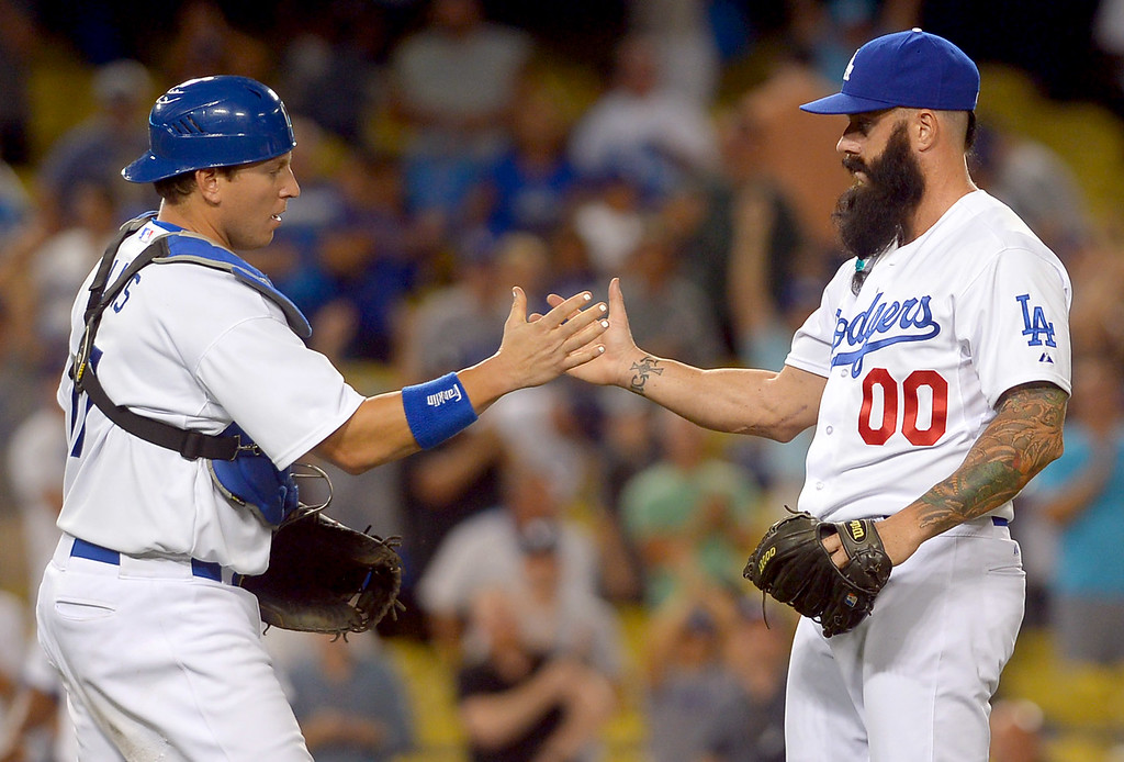 . Dodgers catcher A.J. Ellis congratulates pitcher Brian Wilson after the final out is recorded against the Chicago Cubs August 26, 2013 in Los Angeles, CA.(Andy Holzman/Los Angeles Daily News)