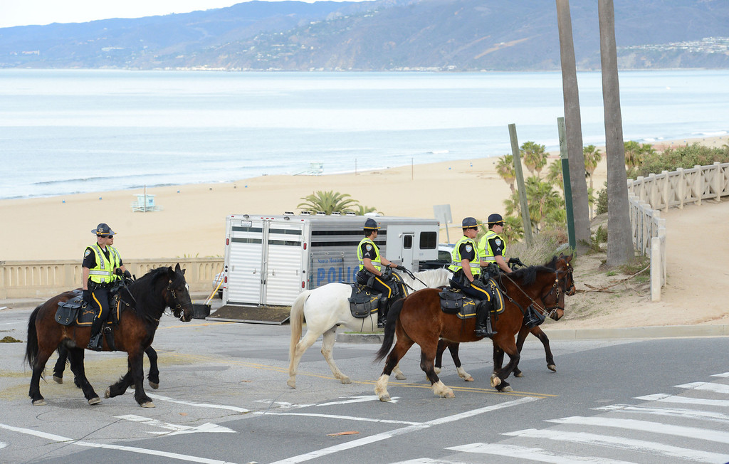 . The Santa Monica Police mounted unit patrolled along Ocean Boulevard, at the finish line of the 2014 ASICS LA Marathon in Santa Monica Calif,    Sunday, March 9,  2014. 