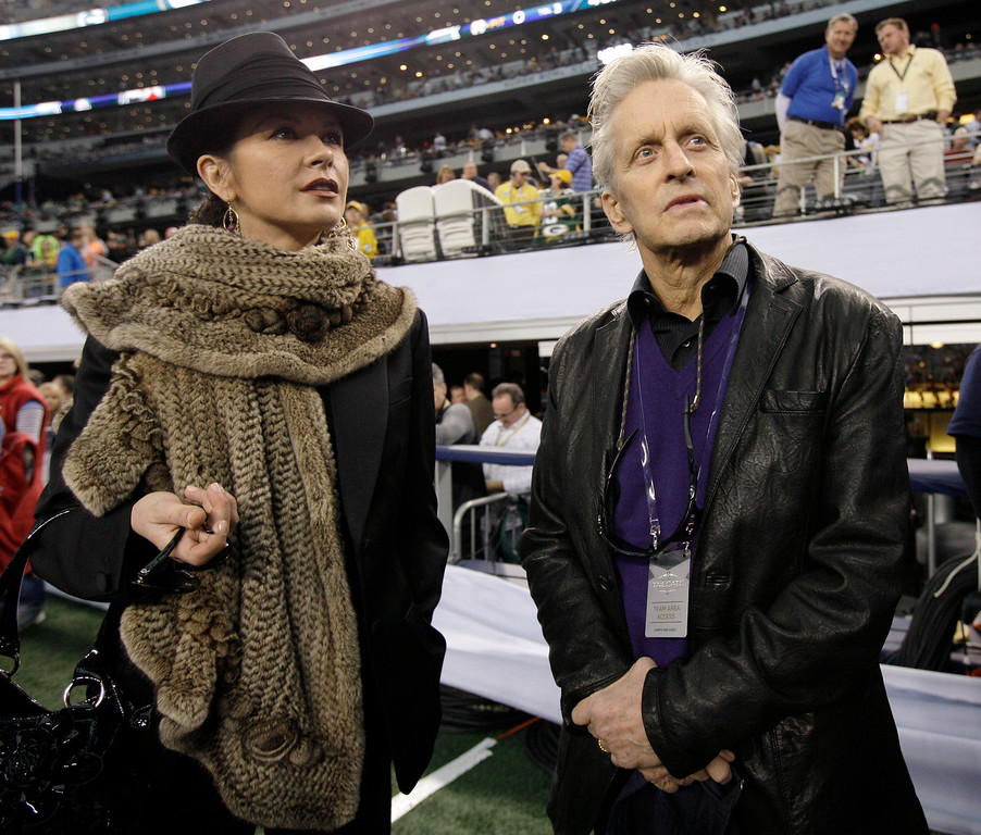 . Actors Michael Douglas, right, and Catherine Zeta-Jones arrive at Cowboys Stadium to watch the NFL football Super Bowl XLV game between the Green Bay Packers and the Pittsburgh Steelers on Sunday, Feb. 6, 2011, in Arlington, Texas. (AP Photo/Paul Sancya)