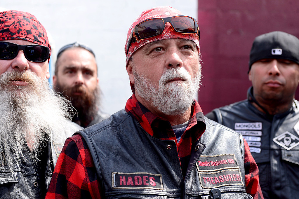 ". Rich ""Hades\"" O\'Henley, of Orange County\'s Devils Rejects, center, attends a rally Saturday, March 29, 2013 at The House Lounge in Maywood in support of the Mongols who are facing a federal trial seeking to take away their trademark patch. (Photo by Sarah Reingewirtz/Pasadena Star-News)"