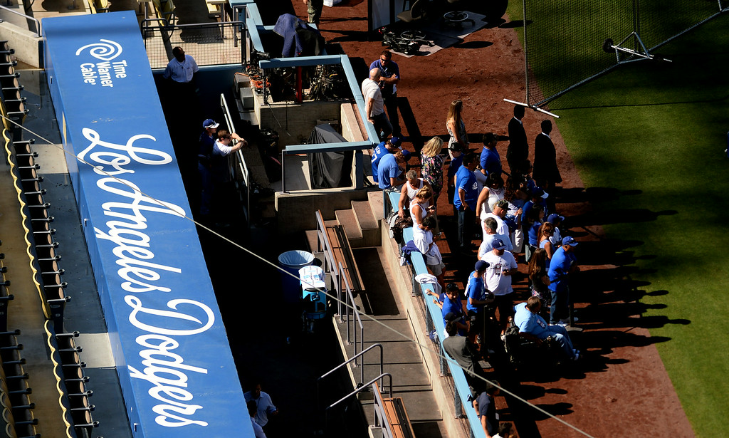 . Fans gather outside the Dodger dugout prior to a Major league baseball game against the San Diego Padres on Saturday, July 12, 2014 in Los Angeles.   (Keith Birmingham/Pasadena Star-News)