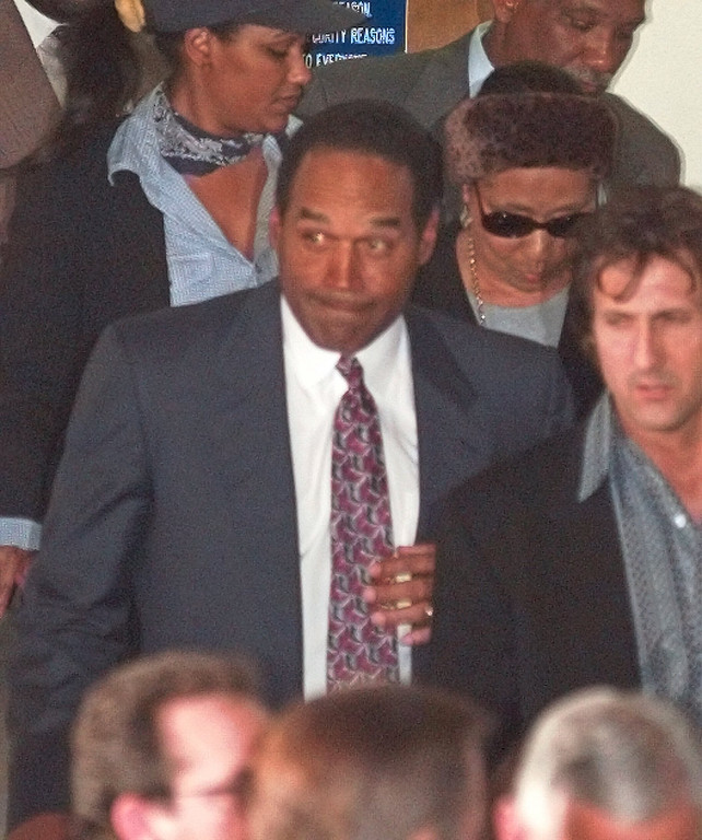 . O.J. Simpson leaves Los Angeles County Superior Court Tuesday, Feb. 4, 1997, in Santa Monica, Calif., after hearing the verdict in the wrongful-death civil trial against him. Simpson was found liable in the deaths of Nicole Brown Simpson and Ron Goldman. (AP Photo/Susan Sterner)
