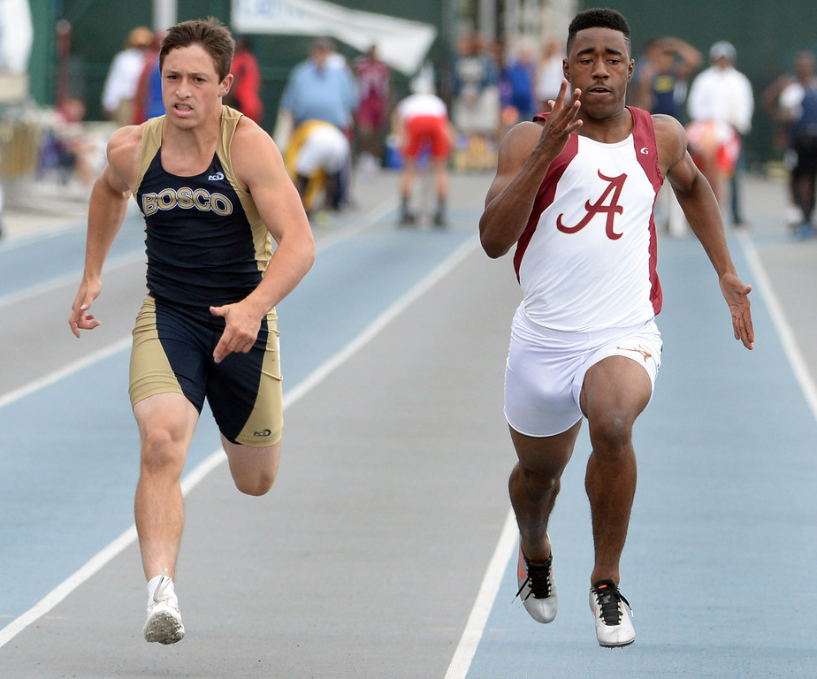 . Alemany\'s Dominic Davis, right, along with Bosco\'s Sean McGew competes in the division 3 100 meter dash during the CIF Southern Section track and final Championships at Cerritos College in Norwalk, Calif., Saturday, May 24, 2014. 