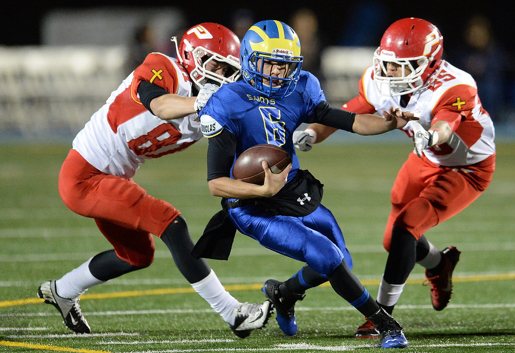 . San Dimas quarterback Josh Avila (6) scrambles against Paraclete in the first half of a CIF-SS Mid-Valley Division championship football game at San Dimas High School in San Dimas, Calif., on Friday, Dec. 6, 2013.   (Keith Birmingham Pasadena Star-News)