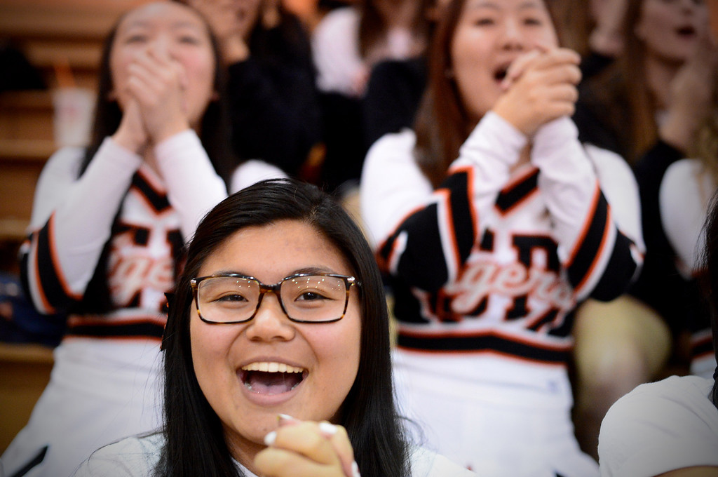 . South Pasadena cheers on their team as they defeats La Canada 66-58 Friday night, January 31, 2014 at South Pasadena High School. (Photo by Sarah Reingewirtz/Pasadena Star-News)