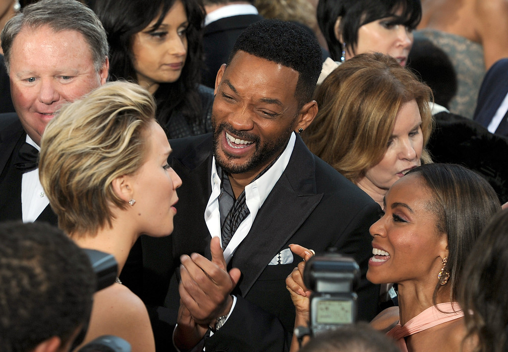. Jennifer Lawrence, Will Smith and Jada Pinkett Smith attend the 86th Academy Awards at the Dolby Theatre in Hollywood, California on Sunday March 2, 2014 (Photo by John McCoy / Los Angeles Daily News)