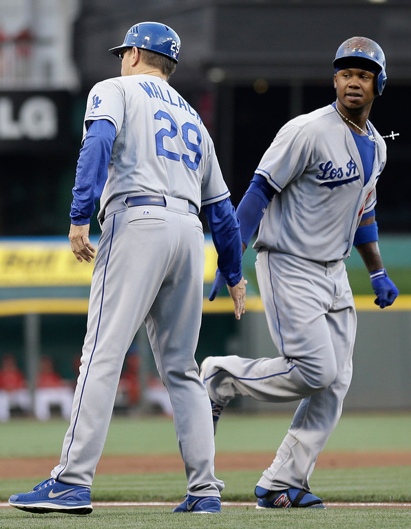 . Los Angeles Dodgers\' Hanley Ramirez is congratulated by third base coach Tim Wallach after Ramirez hit a two-run home run off Cincinnati Reds starting pitcher Mike Leake in the first inning of a baseball game, Friday, Sept. 6, 2013, in Cincinnati. (AP Photo/Al Behrman)