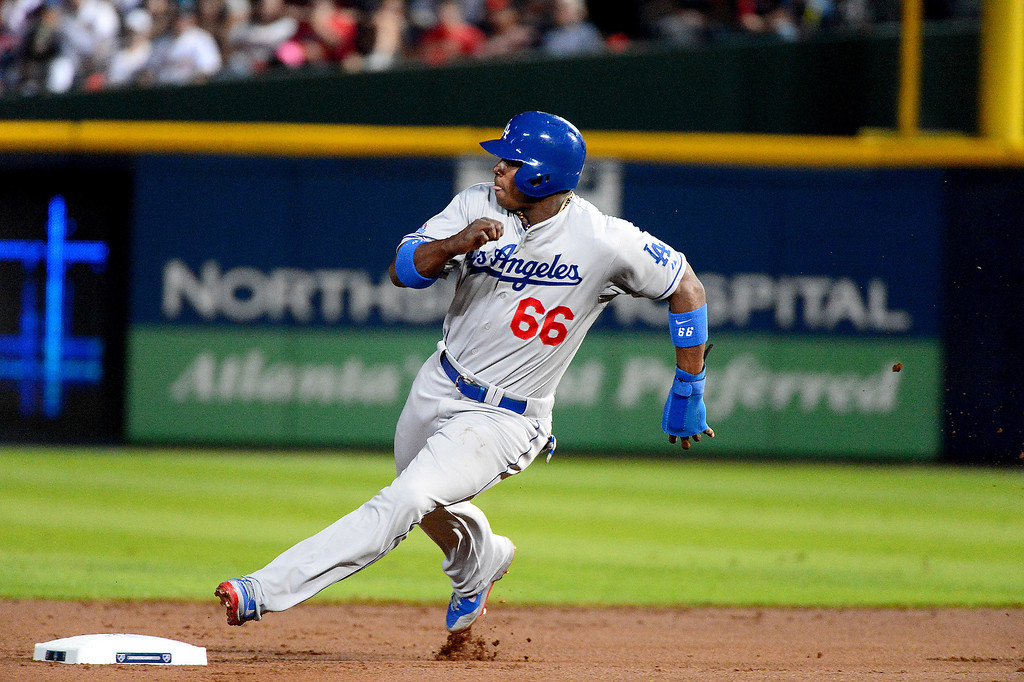 . Los Angeles Dodgers\' Yasiel Puig brings the first run in as they play the Atlanta Braves in the first game of the playoffs Thursday, October 3, 2013 at Turner Field in Atlanta, Georgia. (Photo by Sarah Reingewirtz/Pasadena Star- News)