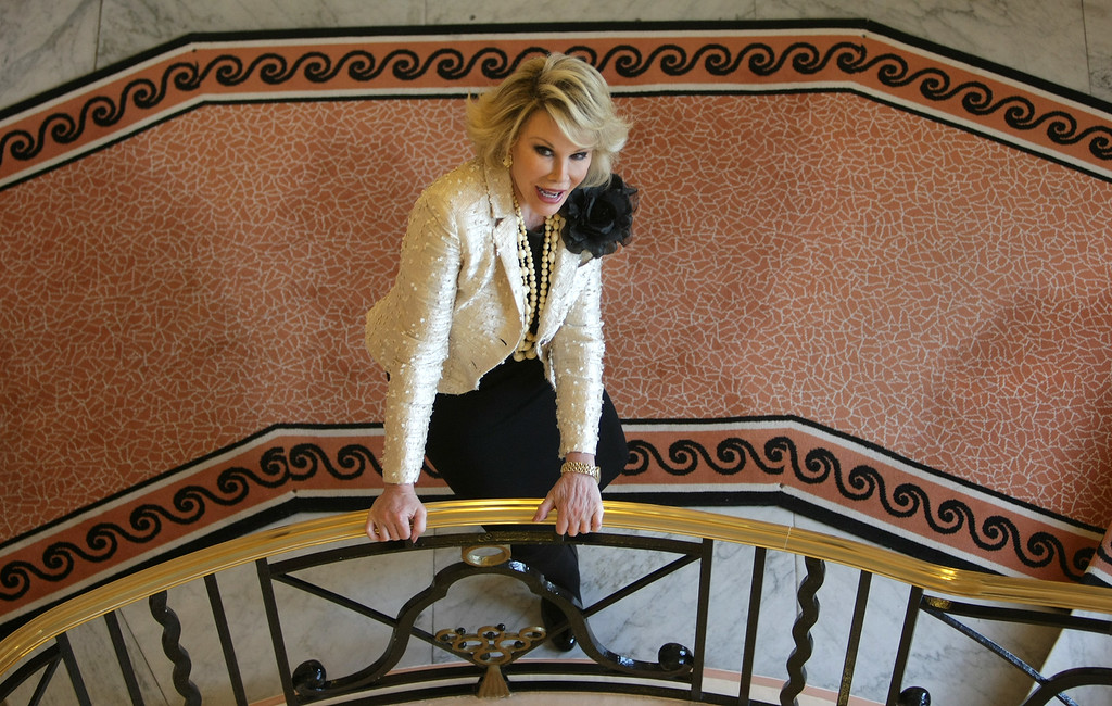 ". American comedic artist Joan Rivers poses for photographers as she presents ""Comedy Roast with Joan Rivers\"" during the 25th MIPCOM (International Film and Programme Market for TV, Video, Cable and Satellite) in Cannes, southeastern France, Monday, Oct 5, 2009. (AP Photo/Lionel Cironneau)"