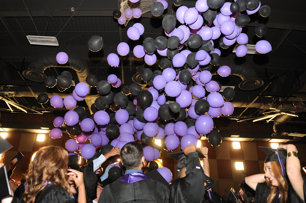. Balloons fall from the ceiling at the end of graduation at the Cesar Chavez Learning Academies Social Justice Humanitas Academy in San Fernando, Wednesday, June 5, 2013. (Michael Owen Baker/Staff Photographer)