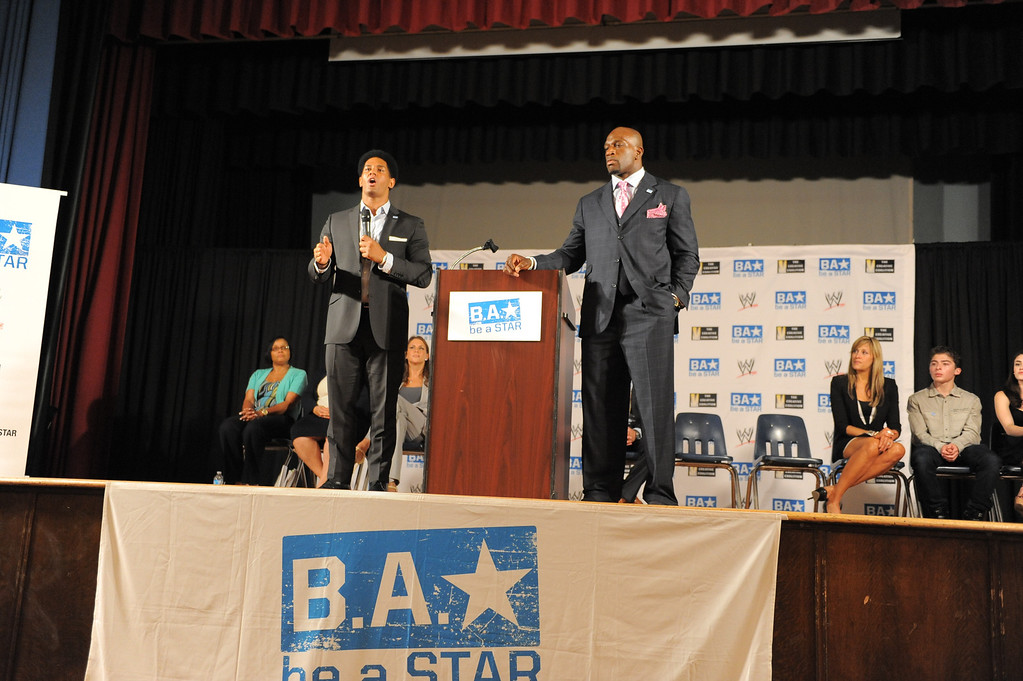 . WWE Superstars Darren Young, left, and Titus O\'Neil speak to kids at Samuel Gompers MS in Los Angeles. WWE  and The Creative Coalition launched the anti-bullying alliance, �Be a STAR� (Show Tolerance And Respect), to provide students with positive tools to prevent bullying in their schools and communities.  The mission of �Be a STAR� is to ensure a positive and equitable social environment for everyone regardless of age, race, religion or sexual orientation through education and awareness. Photo by Brad Graverson 8-15-13