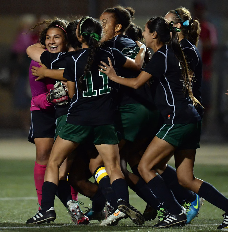 . Granada goalie Andreya Ventura is mobbed by teammates after winning in a shoot-out during their City Section Division I soccer final game against Palisades at Contreras Learning Complex in Los Angeles Saturday, March 8, 2014. (Photo by Hans Gutknecht/Los Angeles Daily News)