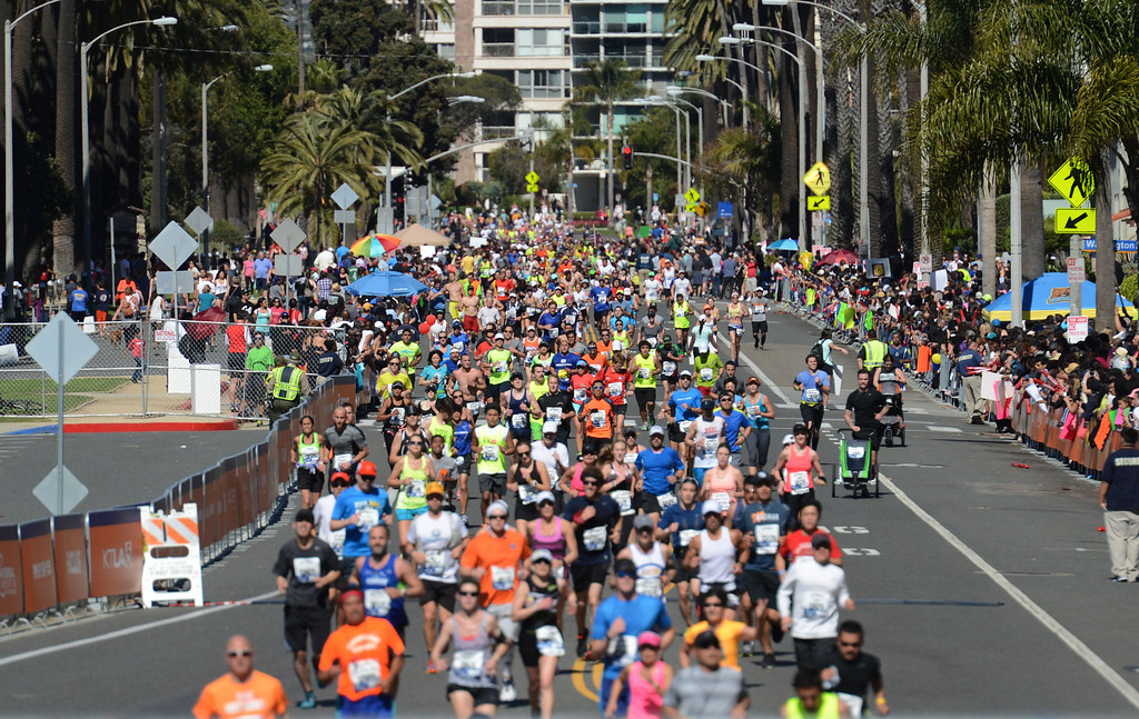 . Runners head along Ocean Boulevard, towards the finish line of  2014 ASICS LA Marathon finisher Bill Hopkins after feeling nauseous after he crossed the finish line in Santa Monica Calif,    Sunday, March 9,  2014. 