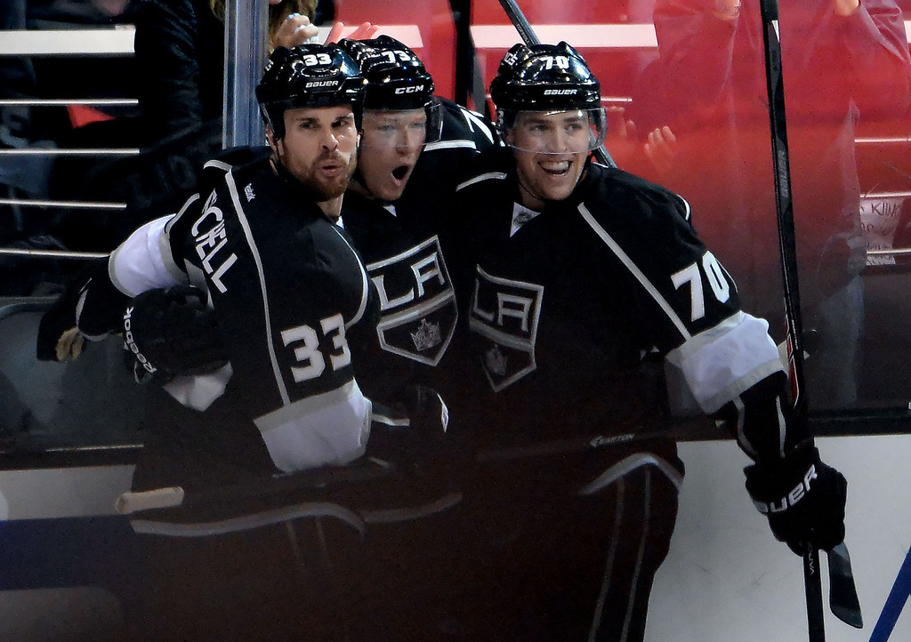 . Los Angeles Kings center Tyler Toffoli, center, celebrates with teammates Willie Mitchell (33) and Tanner Pearson (70) after scoring against the San Jose Sharks during the second period in Game 4 of an NHL hockey first-round playoff series at Staples Center in Los Angeles on Thursday, April, 24  2014.  (Keith Birmingham Pasadena Star-News)