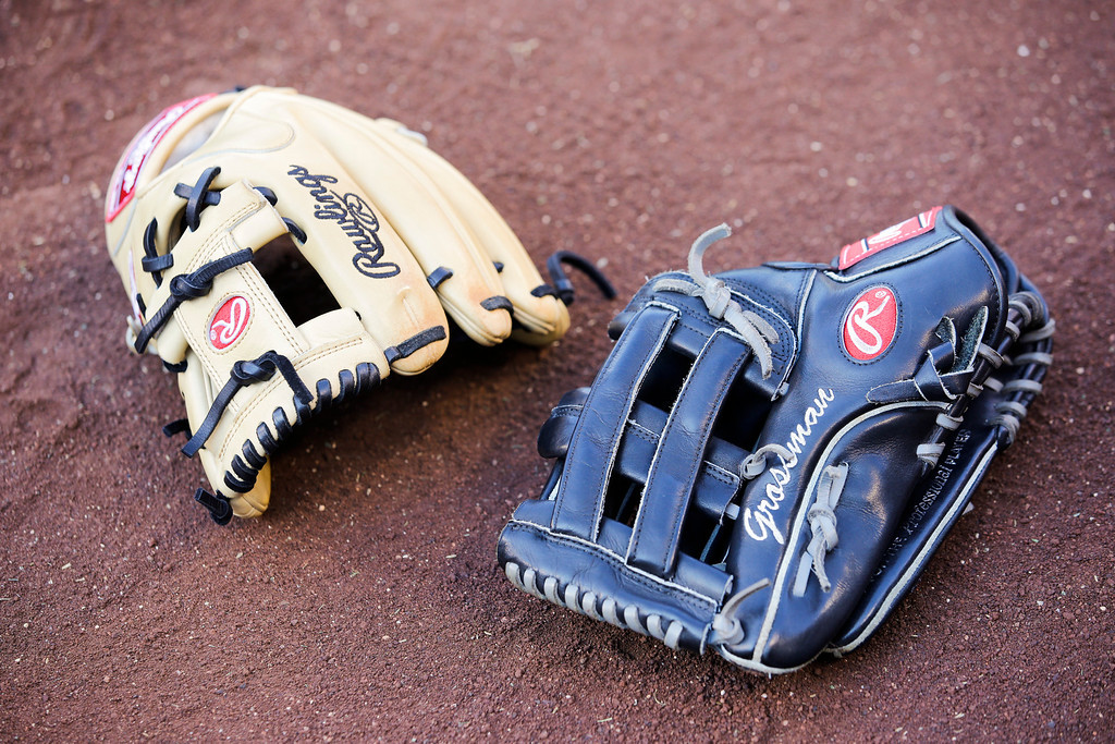 . A baseball glove for Houston Astros\' Robbie Grossman is seen before a baseball game against the Los Angeles Angels on Friday, Aug. 16, 2013, in Anaheim, Calif. (AP Photo/Jae C. Hong)
