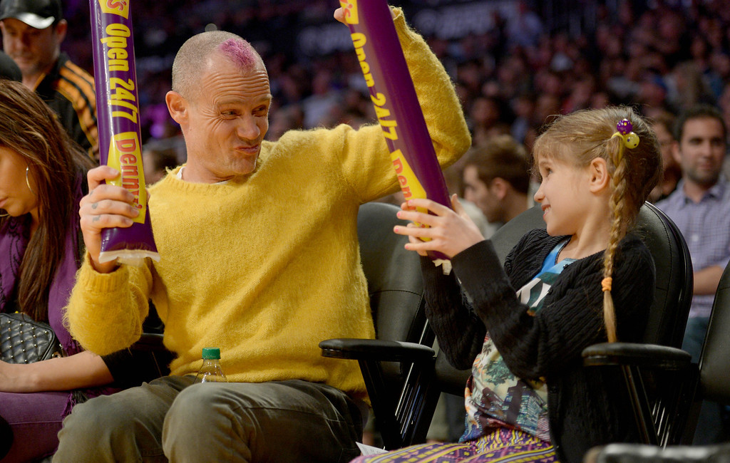 . Flea from the Red Hot Chili Peppers and daughter enjoy themselves as the Los Angeles Lakers host the Chicago Bulls in a NBA basketball game at Staples Center in Los Angeles, CA. on Sunday, February 9, 2014. (Photo by Sean Hiller/ Daily Breeze).