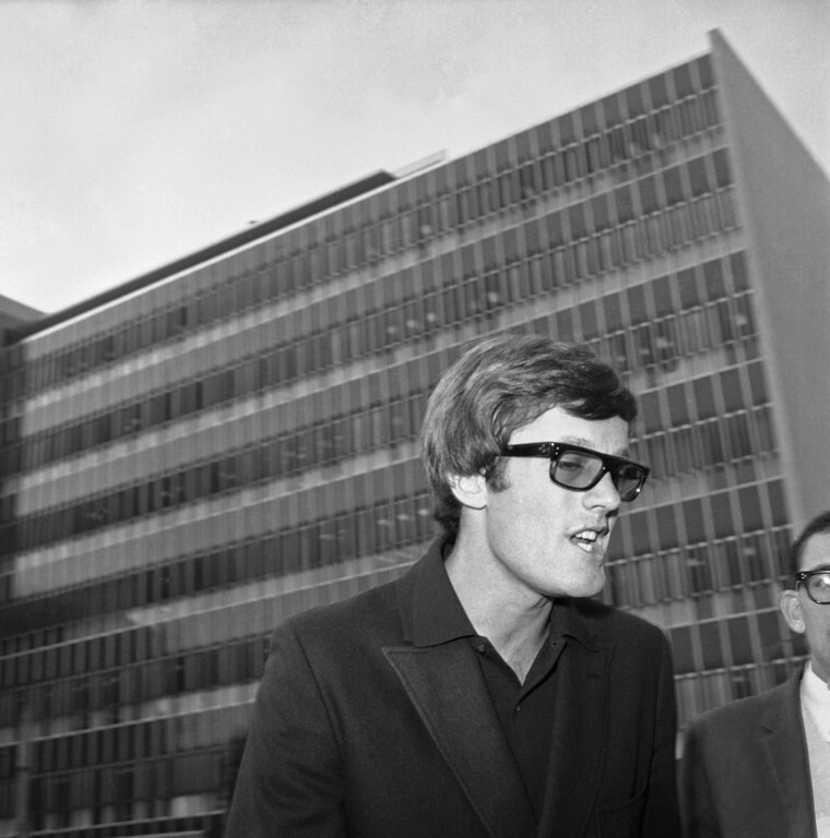 . Actor Peter Fonda leaves a Los Angeles court building after his attorney asked that marijuana possession charges against him and three other men be dismissed, Sept. 27, 1966. A hearing on the dismissal motion will be held on October 7. The four were arrested last month by police who said they found marijuana plants under cultivation at Fonda?s home. (AP Photo/Ellis R. Bosworth)