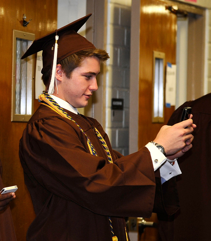 . Grads get some last minute tweet photos out before the start of the Crespi High class of 2013 graduation. May 24.2013.  Photos by Gene Blevins/LA DailyNews