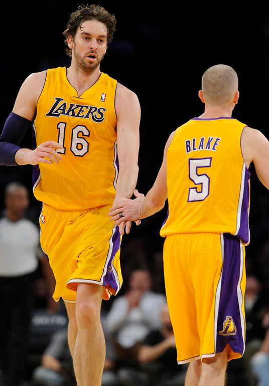 . Lakers#16 Pau Gasol is congratulated by Lakers#5 Steve Blake for his efforts in the first half. The Lakers played the New Orleans Hornets in a game at Staples Center in Los Angeles, CA 1/29/2013 (John McCoy/Los Angeles Daily News)
