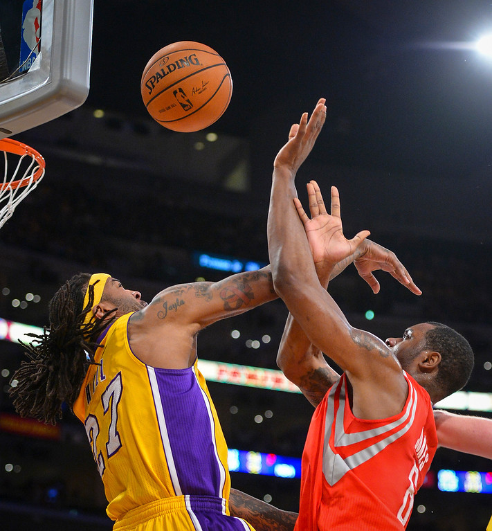 . Lakers� Jordan Hill defends as rockets� Terrence Jones takes a shot during first half action at Staples Center Wednesday, February 19, 2014. ( Photo by David Crane/Los Angeles Daily News )