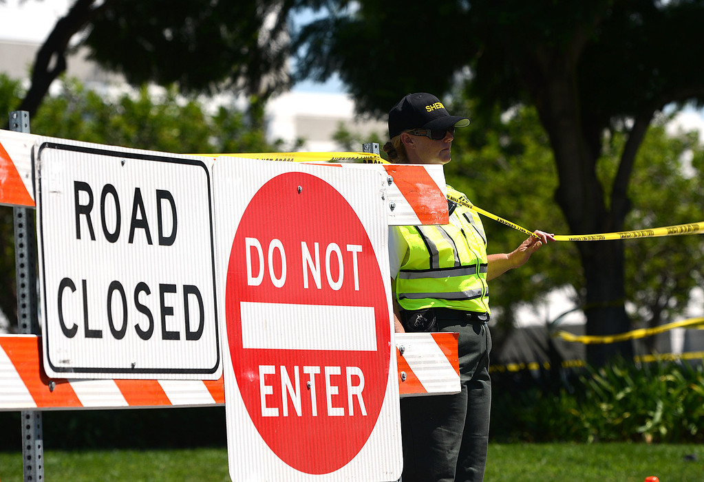 . Investigators look over the scene where a 4-year-old girl died Tuesday, August 27, 2013 after the motorcycle she was a passenger on collided with a big rig on 6th Street near Hermosa Avenue, in Rancho Cucamonga. (Photo by Rick Sforza/Inland Valley Daily Bulletin)