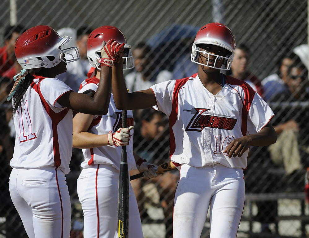 . LONG BEACH, CALIF. USA -- Lakewood\'s Jessica Scroggins (16) celebrates a run with teammate Tyler Burke (11) against Wilson in Lakewood, Calif., on May 2, 2013. Lakewood defeated Wilson 11-1 in five innings.  Photo by Jeff Gritchen / Los Angeles Newspaper Group