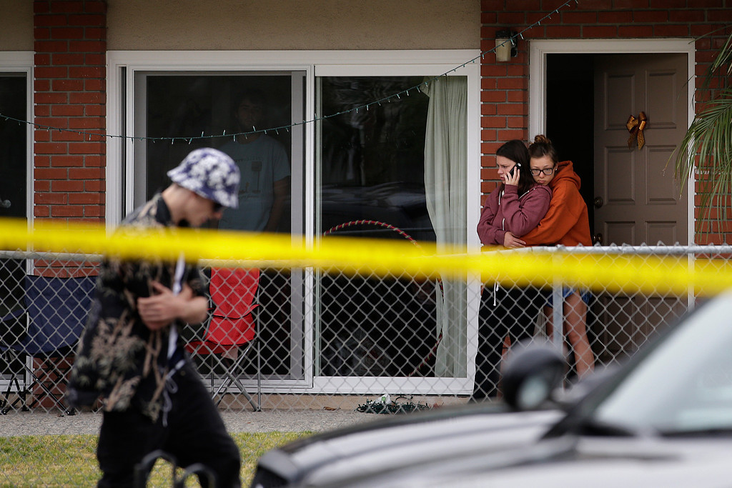 . Two women comfort each other near the scene of a shooting on Saturday, May 24, 2014, in Isla Vista, Calif. A drive-by shooter went on a rampage near a Santa Barbara university campus that left seven people dead, including the attacker, and seven others wounded, authorities said Saturday. (AP Photo/Jae C. Hong)