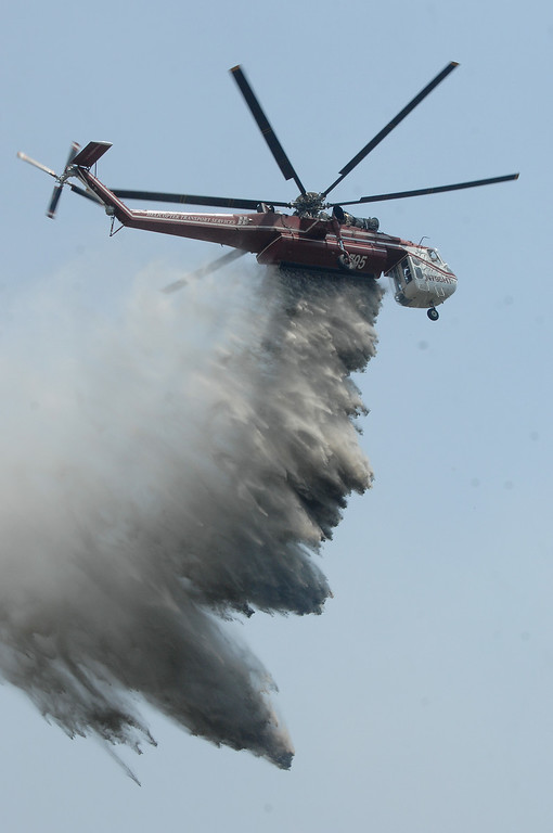 . A sky crane drops water on a hotspot near Potrero Road in Newbury Park, Saturday, May 4, 2013. (Michael Owen Baker/Staff Photographer)