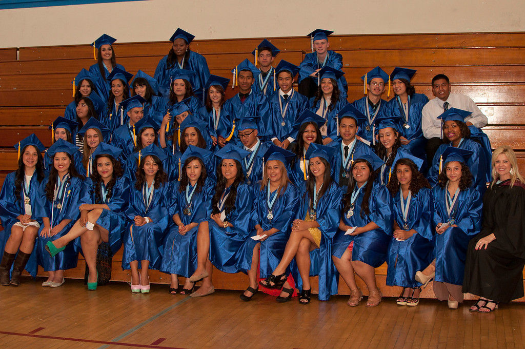 . Reseda seniors take group photos in the school\'s gym before the graduation ceremony begins.  The Reseda High School graduation class held their commencement in the school football field on Friday,  June 07, 2013 in Reseda, CA.   Photo by Carlos Carpio