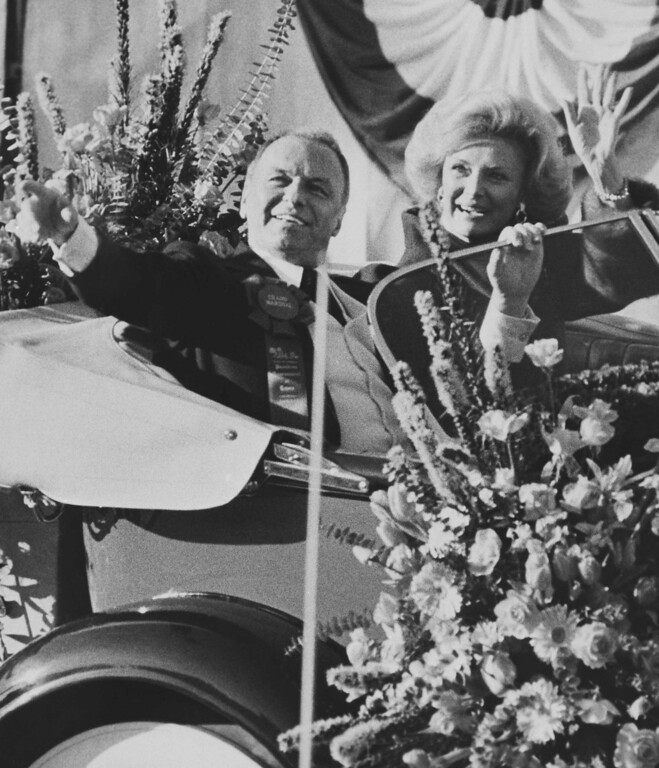 . Entertainer Frank Sinatra and wife, Barbara, wave to the crowd from their convertible in the Rose Parade on Jan. 1, 1980 in Pasadena, Calif. Sinatra is Grand Marshal for the 91st annual event. (AP Photo)
