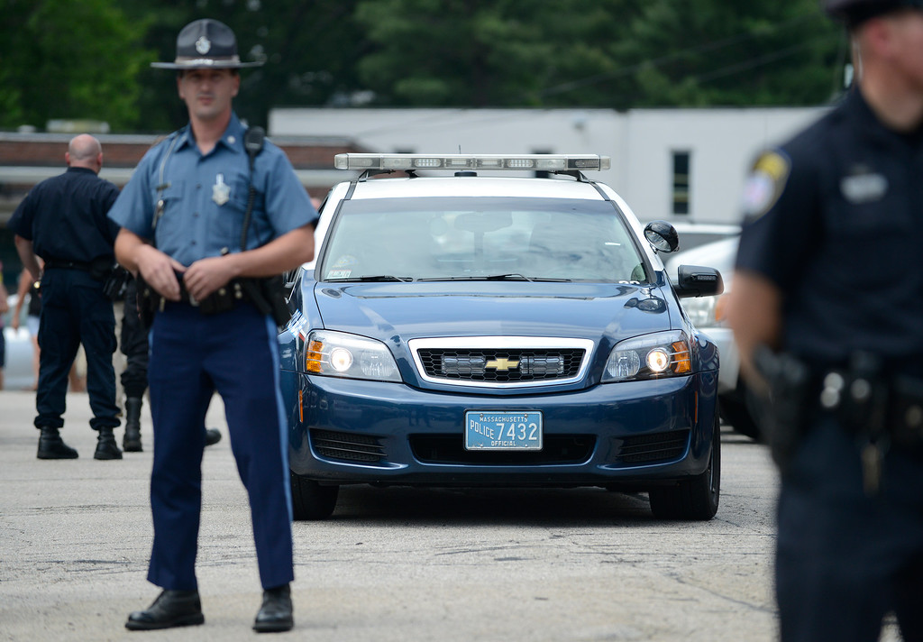 . A police vehicle carrying New England Patriots player Aaron Hernandez arrives at Attleboro District Court after he was arrested on sealed charges related to a murder investigation in Attleboro, Massachusetts, USA, 26 June, 2013. Twenty seven-year-old Odin Lloyd, a semi-pro football player and acquaintance of New England Patriots tight end Aaron Hernandez, was found dead in an empty lot on 17 June 2013 in a industrial area about 1 mile (1.6 km) from the home of Hernandez, in North Attleboro, Massachusetts.  EPA/MATT CAMPBELL
