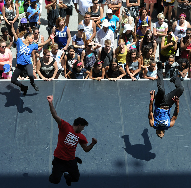 . Contra Tiempo performs on a stage in front of the Dorothy Chandler Pavilion during the 5th Annual National Dance Day celebration at Grand Park and The Music Center. More than 2,000 people participated in the free all-day dance extravaganza.  Los Angeles CA. 7/25/2014(Photo by John McCoy Daily News)