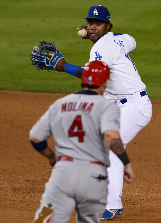 . The Dodgers\'  Hanley Ramirez looks to throw to first after the force on the Cardinals\' Yadier Molina at second game 3 against the St. Louis Cardinals in the NLCS at Dodger Stadium Monday, October 14, 2013. (Photo by Sarah Reingewirtz/Los Angeles Daily News)
