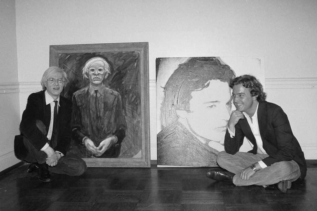 . Artists Andy Warhol, left, and Jamie Wyeth pose beside their portraits of each other in New York, June 2, 1976. (AP Photo/Dave Pickoff)