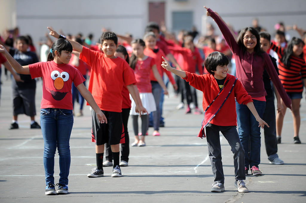 """. Students perform a dance to \""""The Hustle\"""" during the Canoga Park Elementary School Centennial Celebration May 17, 2013.  Live musicians, performances by students, an LAPD helicopter flyover and speakers were featured during the event in Canoga Park, CA Friday.(Andy Holzman/Staff Photographer)"""