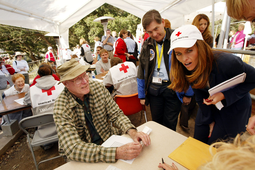 . EL CAJON, CA - NOVEMBER 5:  California first lady-to-be Maria Shriver (R) visits volunteers at the temporary Red Cross Assistance Center where community members are putting their lives back together after loosing more than 200 homes in the Cedar Fire, on November 5, 2003 in El Cajon, California. San Diego County\'s 280,000 plus acre Cedar Fire, the biggest in state history, killed at least 14 people and destroyed thousands of homes.     (Photo by David McNew/Getty Images)