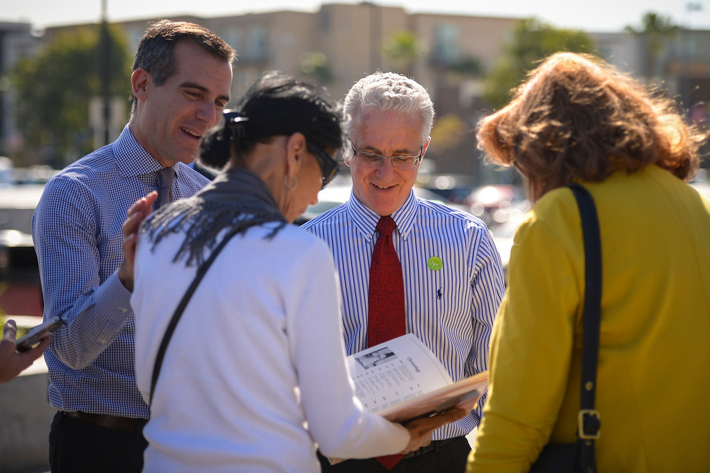 . Los Angeles mayor Eric Garcetti, left, and Councilmember Paul Krekorian  visit with Mary Garica at the North Hollywood Metro station  Monday, March  17, 2014.   ( Photo by David Crane/Los Angeles Daily News )