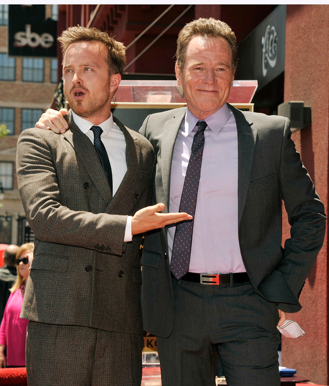 ". Bryan Cranston, right, star of the television series ""Breaking Bad,\"" poses with fellow cast member Aaron Paul after receiving a star on the Hollywood Walk of Fame on Tuesday, July 16, 2013 in Los Angeles. (Photo by Chris Pizzello/Invision/AP)"