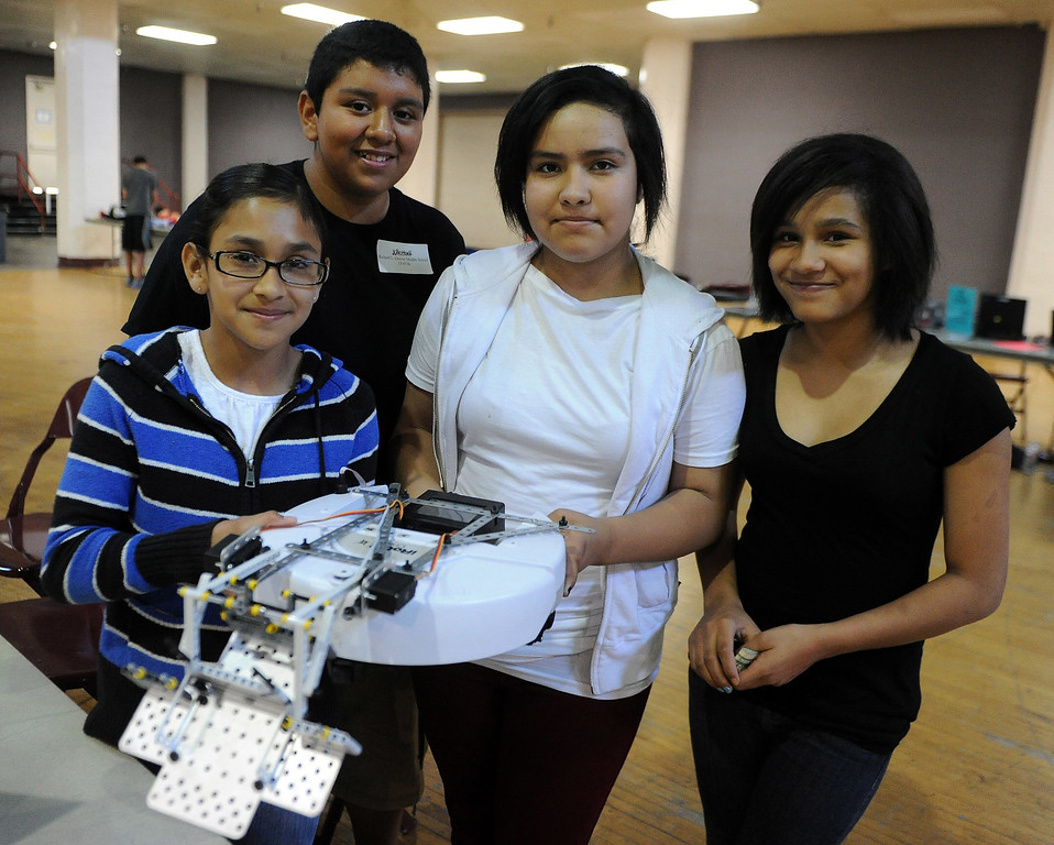 . Daisy Garcia, left, with Christian Gutierrez, Damaris Ochoa, Raquel Rojas, right, of Richard Graves Middle School (Whittier) was unable to participate during the Botball Regional Tournament, part of standards-based educational robotics program. Part of a national program to encourage kids to study math, science. Kids from schools in LA County will compete to see who built best robot at the Shrine Expo Hall on Saturday, March 4, 2013 in Los Angeles.    (Keith Birmingham Pasadena Star-News)
